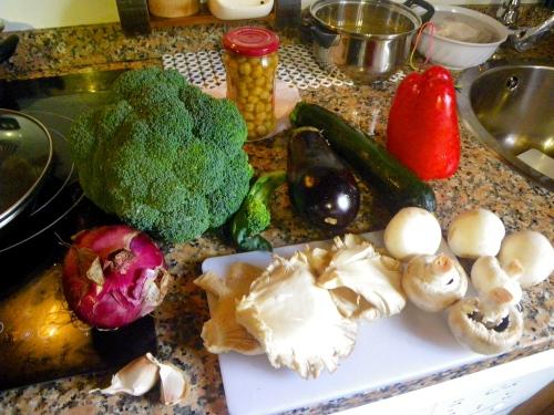 Preparing dinner: chickpeas, various mushrooms and vegetables