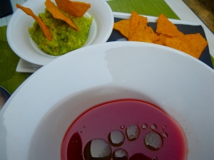 Corn chips with guacamole, and watermelon soup