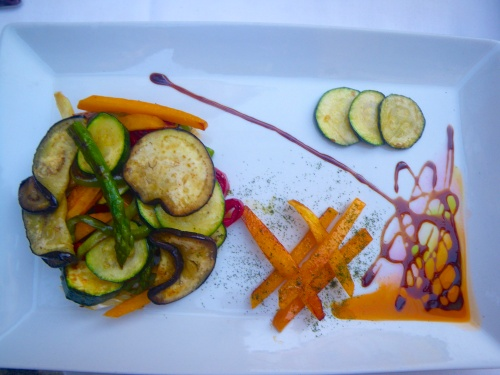 Vegan lunch of grilled vegetables on a bulgur wheat patty