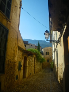 A quiet cobbled residential street in Sóller